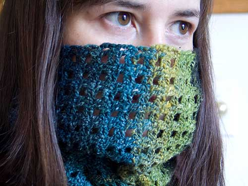 Cowl buttoned tight around the face